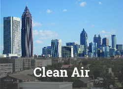 "Atlanta skyline on a clear day with ""Clean Air"" label."