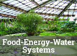 """Image of greenhouse interior with the label, """"Food-Energy-Water Systems."""""""